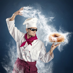 Chef sprinkle powdered sugar donut