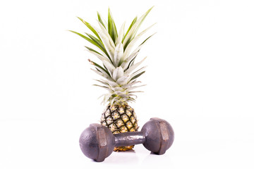 dumbell and pineapple isolated on white.