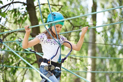 canvas print picture Girl is climbing to high rope structures