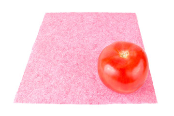 Red tomato on a pink napkin
