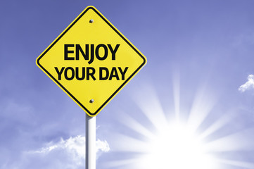 Enjoy your Day road sign with sun background