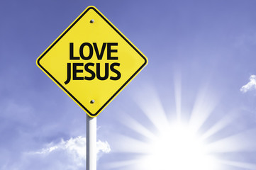 Love Jesus road sign with sun background