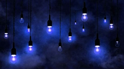 Incandescent bulbs hanging, smoke motion, blue background