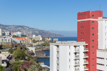 Madeira island with modern hotels in the capital city Funchal