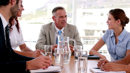 Business people talking during meeting