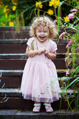 laughing child on garden steps