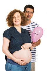 Future parents holding pink balloon