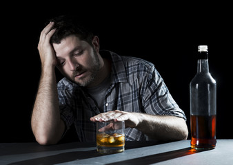 drunk alcoholic man drinking whiskey in alcoholism concept
