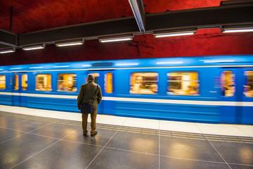 Train arrives Solna Centrum metro station, Stockholm (Sweden)