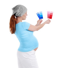 Pregnant woman making a decision of color for a nursery