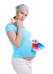 Pregnant woman choosing a color for a nursery