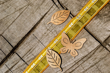 wooden decoration, butterflies, leaves, ribbon, yellow