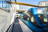 Train arrives at Skarmarbrink metro station, Stockholm (Sweden)