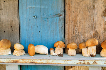 Some mushrooms on wooden background