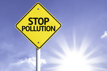 Stop Pollution road sign with sun background