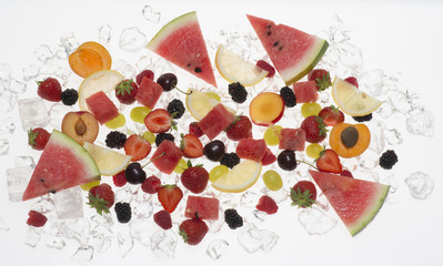 fruits with ice on white background