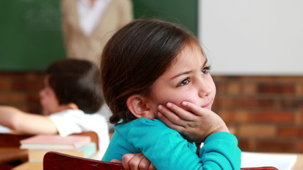 Little girl thinking hard during class