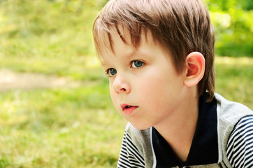 boy looking away with interest in the park