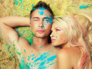 Romantic couple painted colored powders
