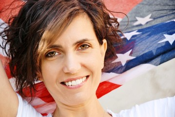 Closeup beautiful young brunette, american flag background