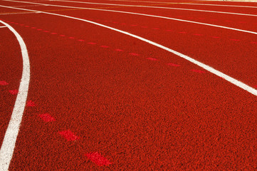A running racetrack constructed with red rubber cover