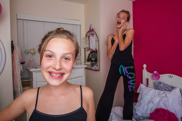 Two young girls playing in their room
