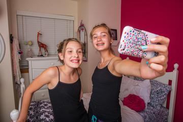 Kids taking selfie in room