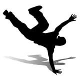 silhouette di ragazzo che balla hip hop