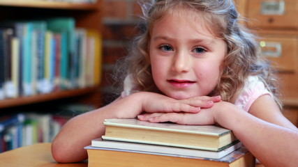 Little girl smiling at camera in the library