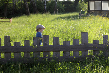 Child and lath fence