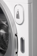 Detail of liquid soap container in washing machine.
