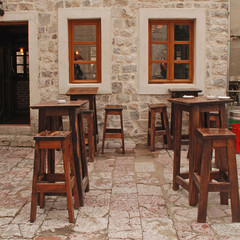 Outdoor cafe with wooden furniture, Italy