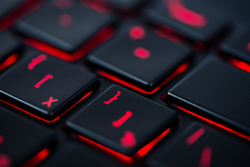 Modern red backlit keyboard, concept computer background