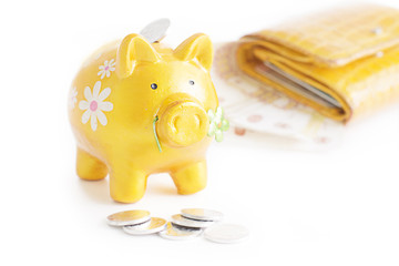 Golden piggibank with coins isolated