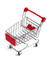 Small red shopping cart isolated