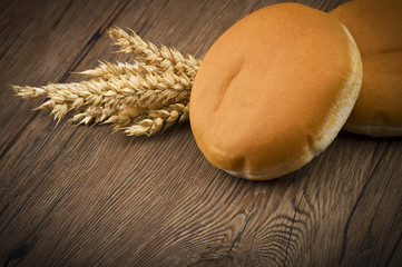 Sandwich for hamburger with ears of corn on wood