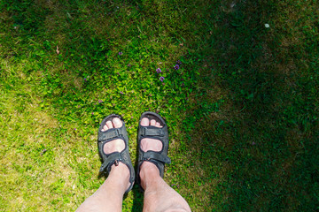 Feet fronted with sandals