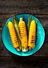 Three grilled corns