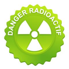 danger radioactif sur bouton web denté vert