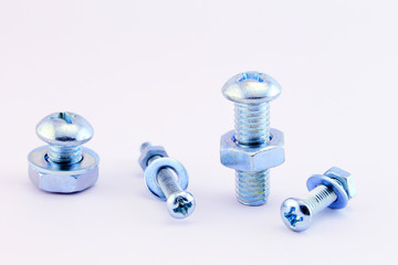 Nuts, screws and washers isolated on white