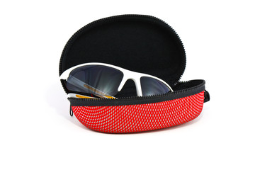 Sport sunglasses and case on a white background