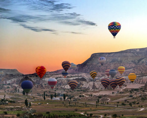 Hot air balloons fly over Cappadocia