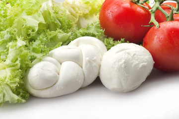 Mozzarella tomatoes and fresh salad on the white