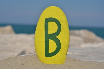 B, second letter of the alphabet on a stone
