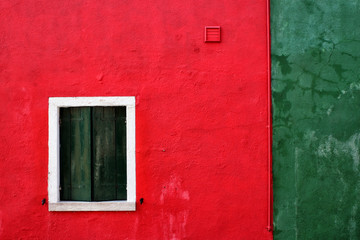 Red and green wall with window in Burano, Venice