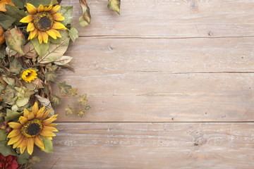 Fall border with sunflowers on a grunge wood background