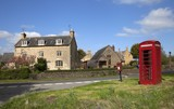 Fototapety Cotswold village with phone box