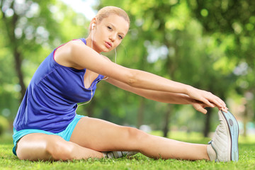 Young blond woman exercising outdoors