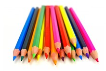 Cluster of colorful pencil crayons over a white background