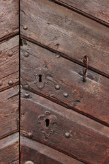 Detail of an old wooden doorway with metal lock and handle